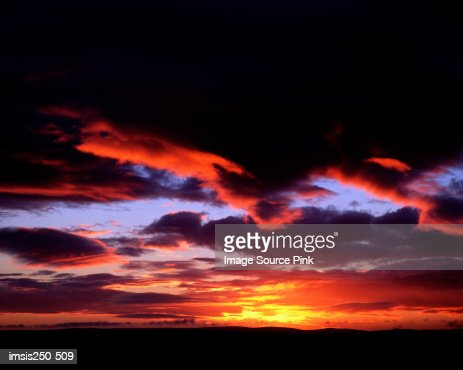 Sunset over cloudy sky : Stock Photo
