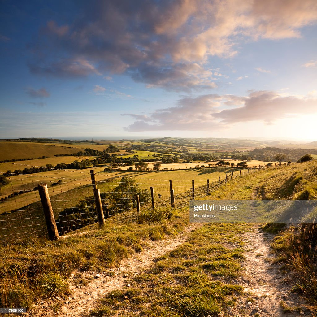 Sunset over English countryside with footpath in Dorset