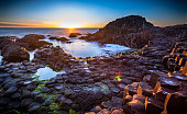 Sun setting over the famous Giants Causeway, Northern Ireland.