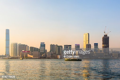 Sunset over Kowloon skyline in Hong Kong : Stock Photo