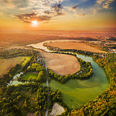 Beautiful sunset over Czech Valley Reservoir in The Litice suburban district of Pilsen.  Aerial view to scenic landscape in Czech Republic, Central Europe. HDR (warm filtered) photography.