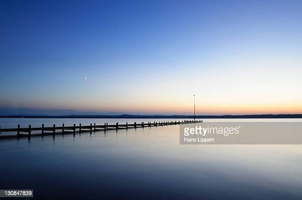 Sunset over Lake Starnberg, dock near Ambach, Muensing municipality, Bavaria, Germany, Europe