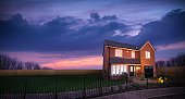 Sunset over landscape and energy efficient house