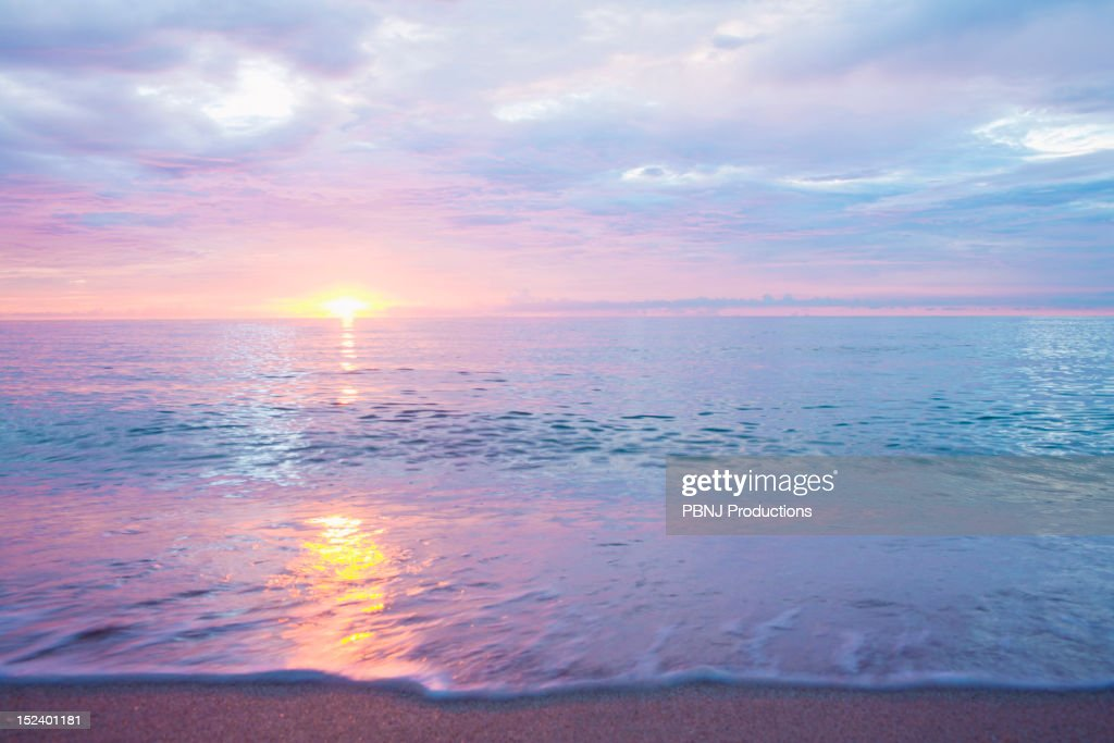 Sunset over ocean : Stock Photo