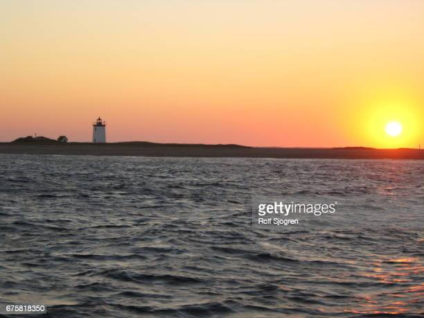 Sunset over Provincetown harbor, with lighthouse
