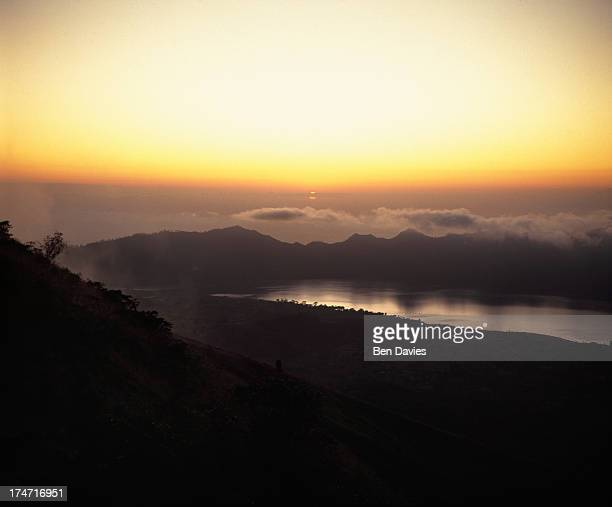 Sunset over spectacular Lake Batur viewed from the crater rim at Penelokan in Bali This spot is popular with tourists who also come here to climb...
