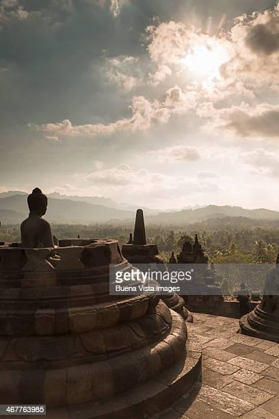 Sunset over Stupas of Buddhist temple of Borobudur