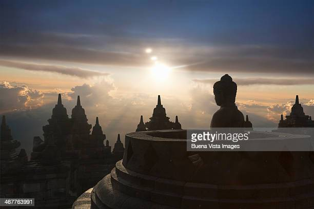 Sunset over Stupas of Buddhist temple of Borobudur