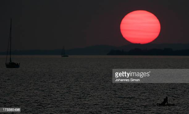 A sunset over the Bodensee is seen ahead of the rehearsal of the opera 'Die Zauberfloete' of Austrian composer Wolfgang Amadeus Mozart at Seebuehne...