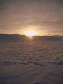Sunset over the frozen Arctic landscape