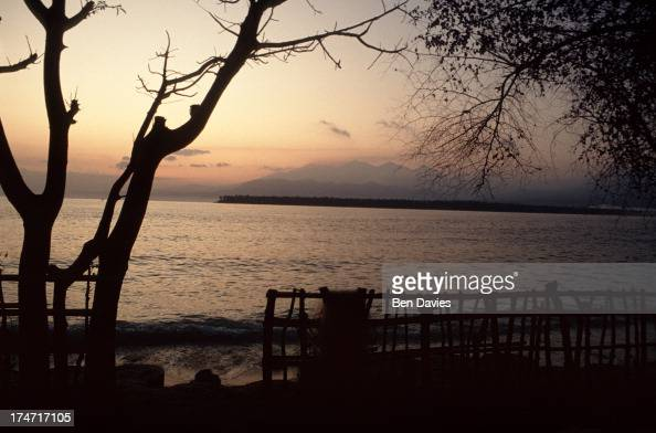 Sunset over the Lombok straits viewed from the idyllic Gili Air Island in Indonesia The Gili islands have fine white sandy beaches and palms and are...