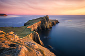 Sunset over the Neist Point Lighthouse, Isle of Skye, Scotland, UK. Neist Point (Scottish Gaelic: Rubha na h-Eist) is a viewpoint on the most westerly point of Skye. Neist Point Lighthouse has been lo