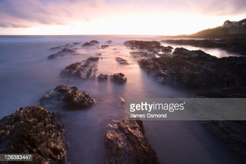 Sunset over the rocks at Croyde Bay in Devon. : Stock Photo