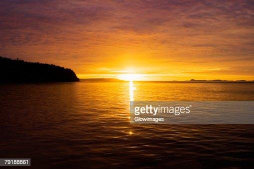 Sunset over the sea, Bangka Island, Sulawesi, Indonesia : Foto de stock