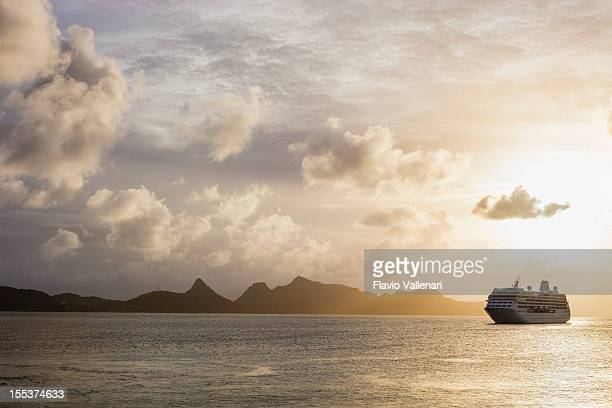Sunset over the sea with a cruise ship in Grenadines