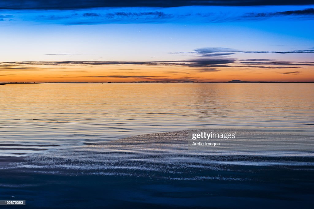 Sunset over the water : Stock Photo