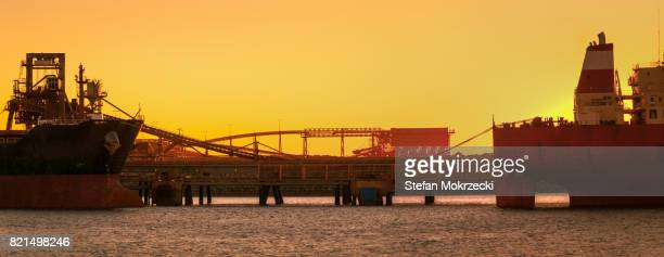 Sunset Panoramic Of Iron Ore Ships At Port Hedland, Australia