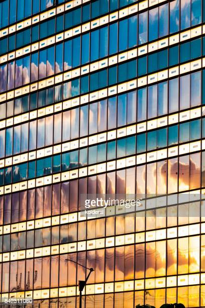 Sunset reflected in office building