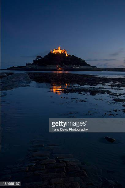 Sunset reflections on causeway St Michael's Mount