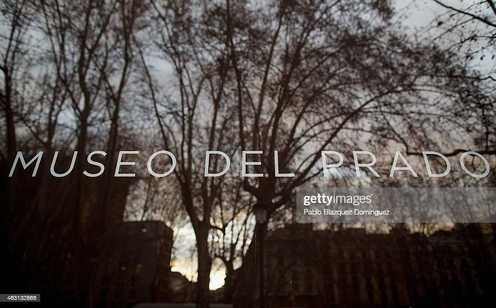 A sunset reflects on a glass window reading 'Prado Museum' outside the Prado Museum on February 10 2015 in Madrid Spain The Prado Museum is running...