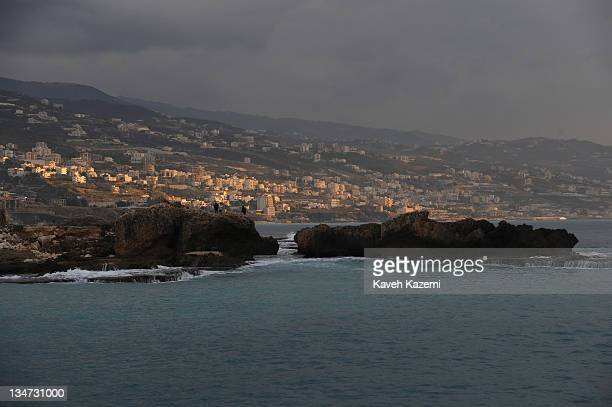 A sunset scene of coastal housing viewed from Byblos bay Byblos Lebanon