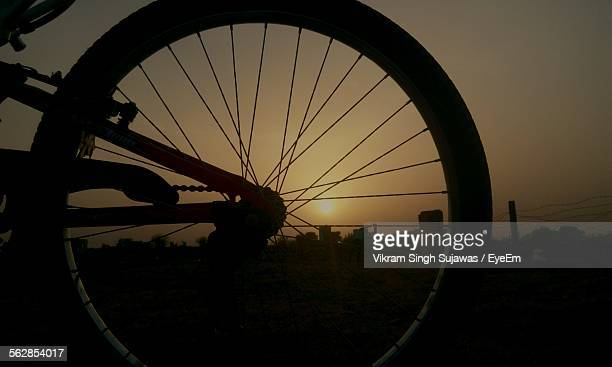 Sunset Seen Through Bicycle Wheel