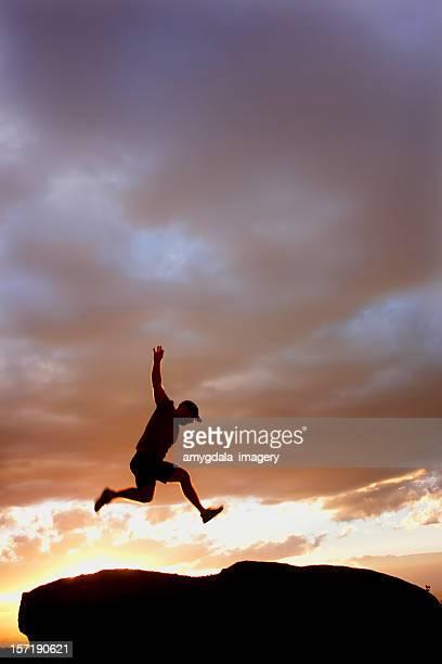 sunset silhouette man jumping