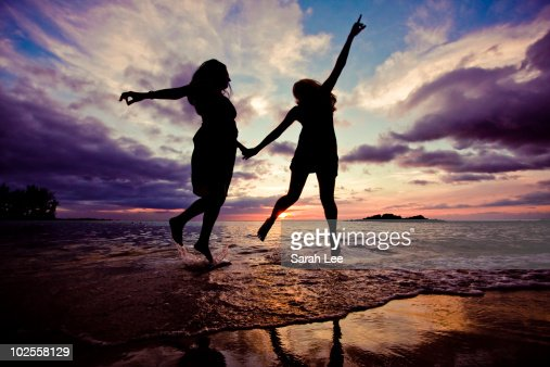 Sunset silhouetted women