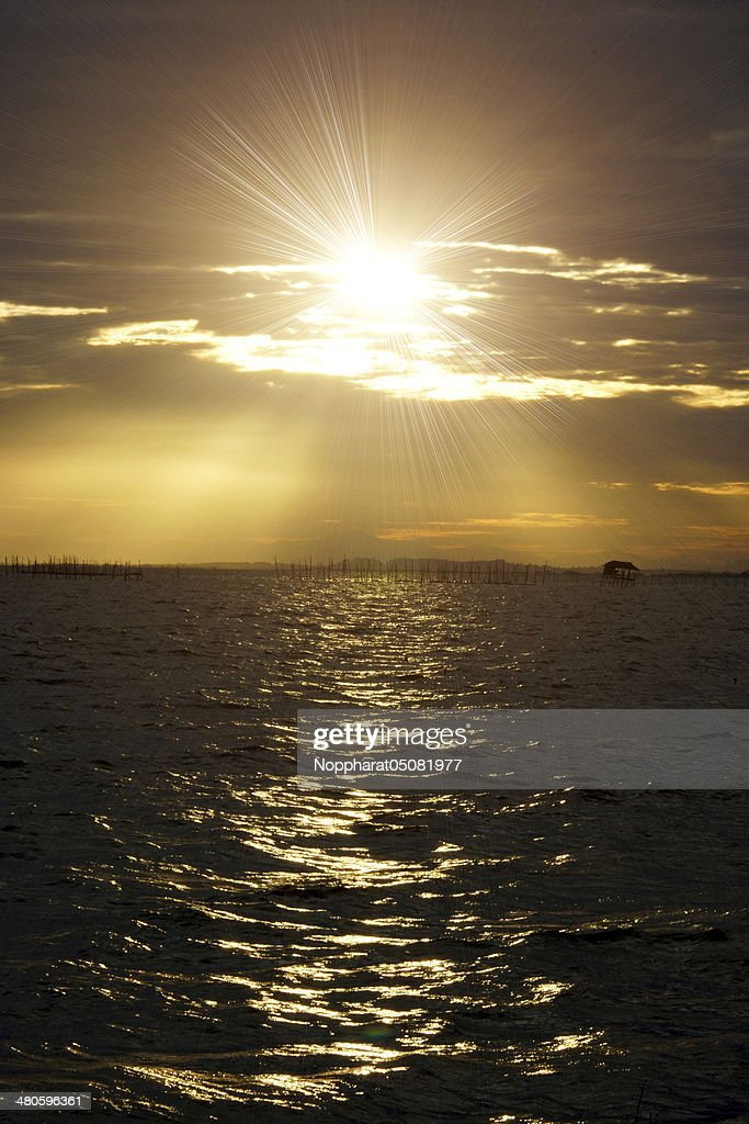 sunset sky at the lake. south of Thailand. : Stock Photo