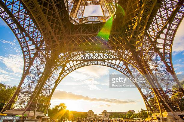 Sunset under the arch of Eiffel Tower, Paris - France