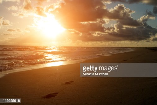 Sunset View And Footprints In Sand Stock Photo | Getty Images