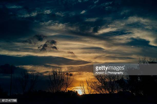 Sunset With Dramatic Blue Cloudy Sky