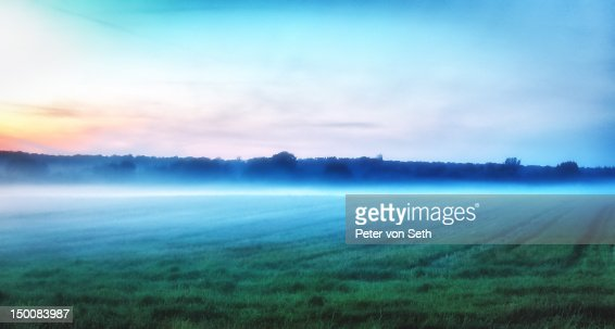 Sunset with evening mist : Stock-Foto