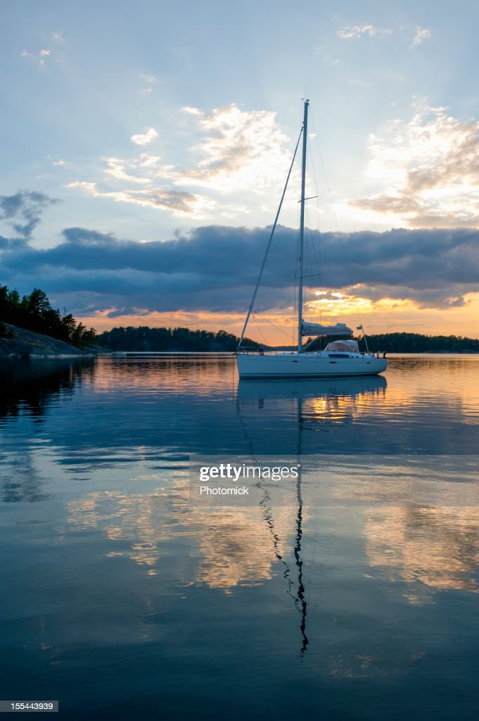 Sunset with sailboat at anchor in the archipelago