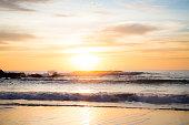 Sunsetting over a beach.
