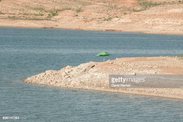 A sunshade is seen at Entrepenas reservoir second largest water reservoir feeding the Segura River and Spain's Southeastern regions which is at 12%...