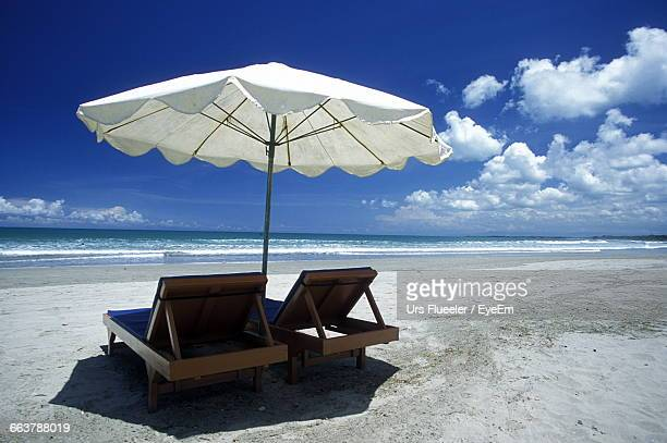 Sunshade Over Lounge Chairs At Beach