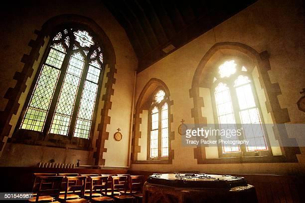 Sunshine & church windows light a baptismal font