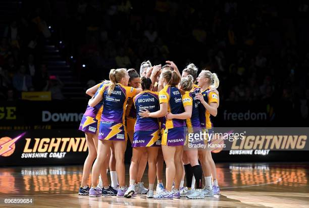 Sunshine Coast Lightning players embrace before the Super Netball Grand Final match between the Lightning and the Giants at the Brisbane...