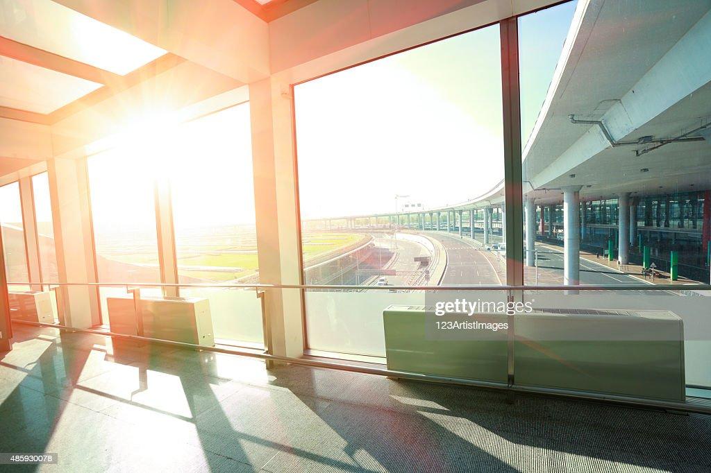 Sunshine On Modern Glass Office Building Interior Corridor : Stock Photo