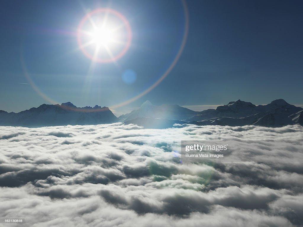 Sunshine over mountains  emerging from  fog