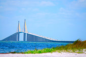 Sunshine Skyway Bridge crossing Tampa Bay in Florida with a beach in the foreground.