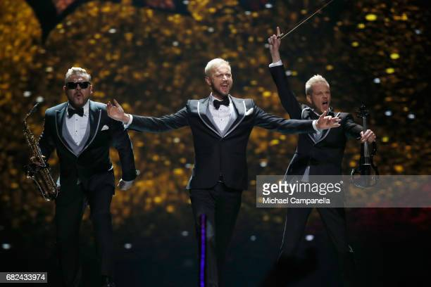 Sunstroke Project representing Moldova are seen on stage during the rehearsal for ''The final of this year's Eurovision Song Contest'' at...