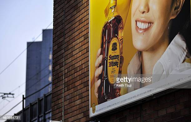 Suntory advertising billboard is displayed on January 14 2014 in Tokyo Japan Japanese company Suntory Holdings acquired Beam Inc for $136 Billion in...