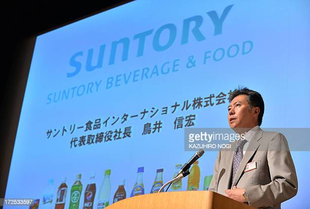 Suntory's foodandbeverage president Nobuhiro Torii delivers a speech during a press conference after a ceremony marking the company's listing on the...