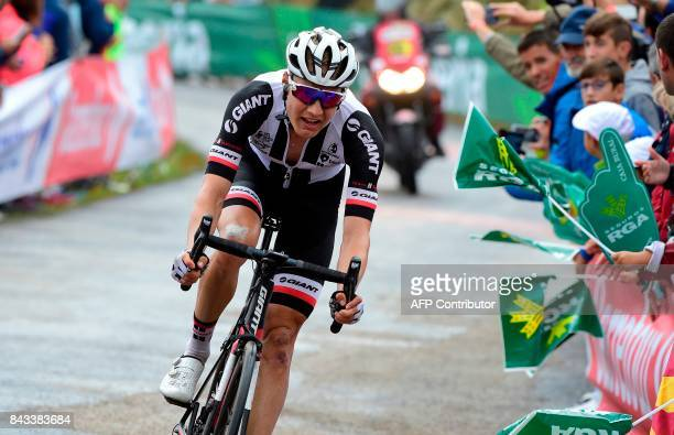 Sunweb's Dutch cyclist Wilco Kelderman crosses the finish line of the 17th stage of the 72nd edition of 'La Vuelta' Tour of Spain cycling race a 1805...