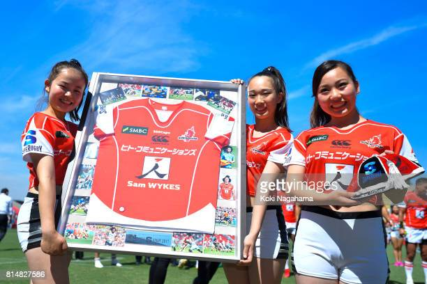 Sunwolves cheer leaders pose for photos during the ceremony after winning the Super Rugby match between the Sunwolves and the Blues at Prince...