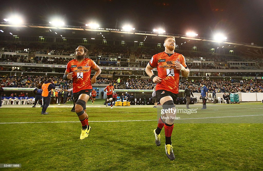 Sunwolves players run onto the field before the round 14 Super Rugby match between the Brumbies and the Sunwolves at GIO Stadium on May 28, 2016 in Canberra, Australia.