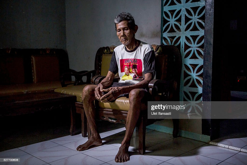 Supar, 75 years old, a villager who witnessed Indonesia's anti-communist massacre, sits inside his house in Wonosari village on May 03, 2016 in Semarang, Central Java, Indonesia. Supar, was at a massacre site when the military opened fire on the victims, who all had suspected ties to the Indonesian Communist Party (PKI). Survivors of Indonesia's anti-communist massacres called for investigations into the country's purges, in which possibly half a million to one million people died beginning October 1965, during the crackdown by the Indonesian government and military after an attempted coup by suspected communists.