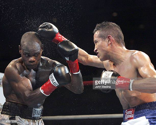 Super Bantamweight's Felix Flores and Fernando Beltran Jr in action during 'Fight Night at the Tank' July 21 2005 at HP Pavilion in San Jose...